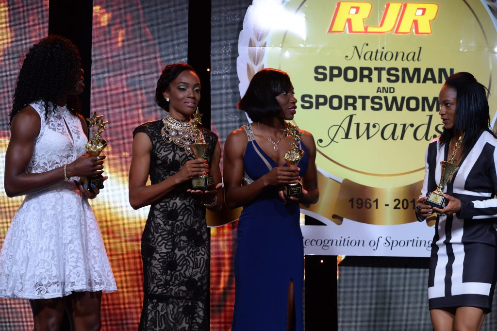 Athletes (L-R), Shericka Jackson, Christine Day, Novlene Williams -Mills and Anastasia Leroy posed with trophy at the 2015 Sports Awards (1)