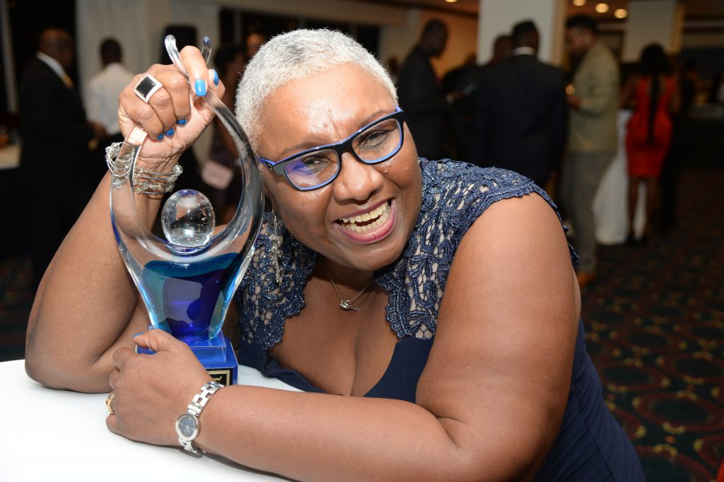 Marva Bernard, Sagicor Iconic and Lifetime Achievement recipient posed with trophy at the 2015 Sports Awards. (2)
