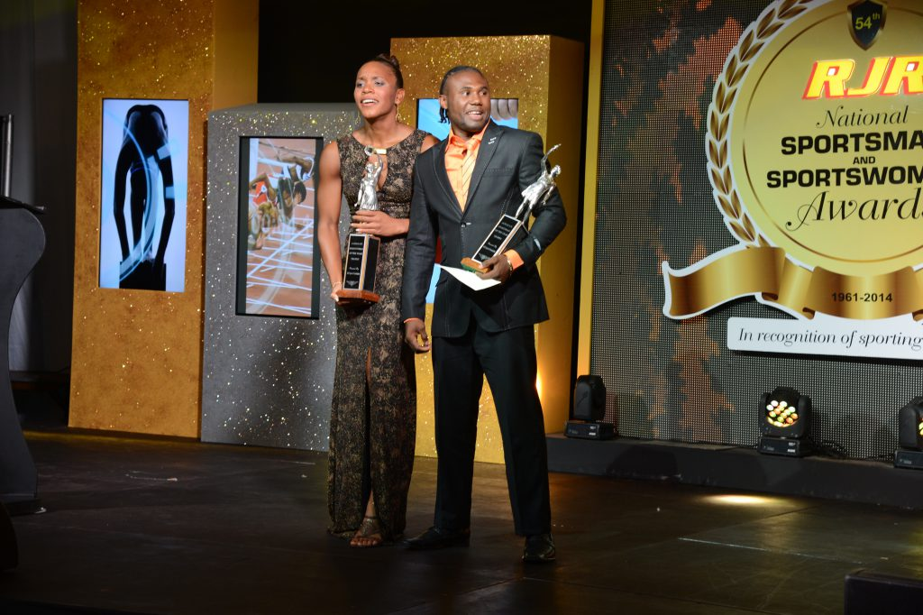 Sportsman and Sportswoman of the Year 2014, Nicholas 'Axeman Walters and Alia Atkinson posed with trophy at the 54th Staging of the RJR Sports Awards